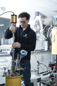 Dr Joey Walker inserting a probe into the EffecTech cryostat